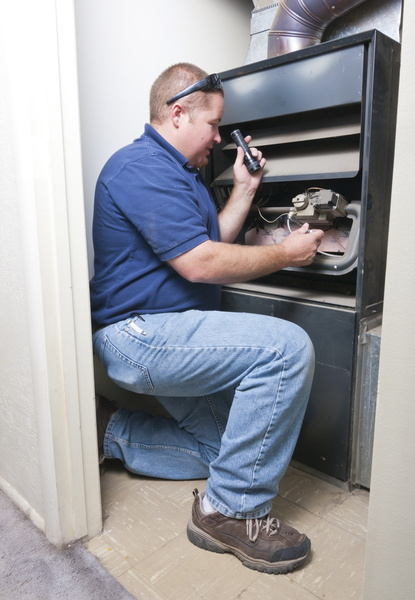 technician-looking-over-furnace