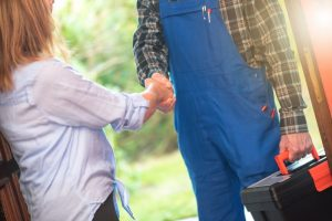 homeowner-shaking-hand-with-service-professional