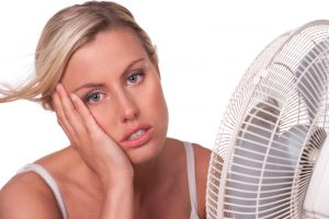 woman-in-front-of-fan-overheated