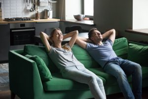 couple-relaxing-on-couch-in-home